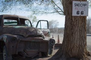 Rusted pickup and Route 66 sign - North America